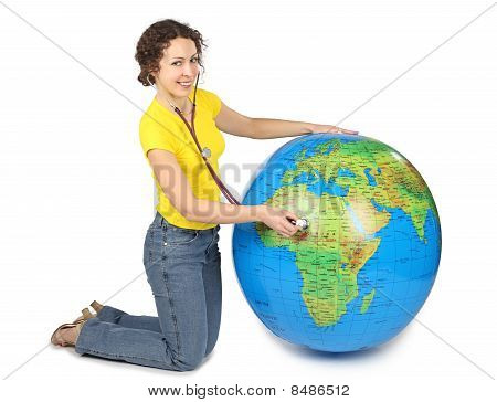 Young Beauty Woman With Stethoscope And Big Inflatable Globe, Smiling And Looking At Camera