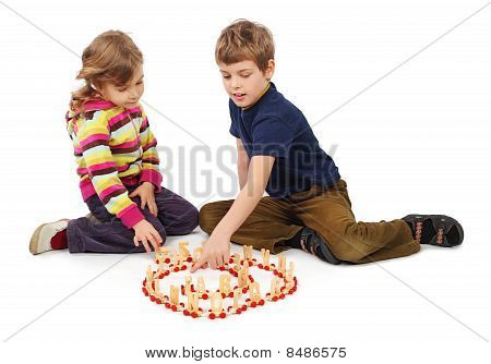 Little Boy And Girl Playing With Wooden Railway Sitting On Floor, Full Body, Train In Spiral