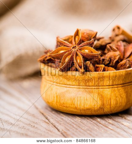 spice anise on wooden background with selective focus