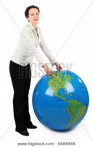Young Woman In White Jacket Standing And Pointing At North America On Big Inflatable Globe, Isolated