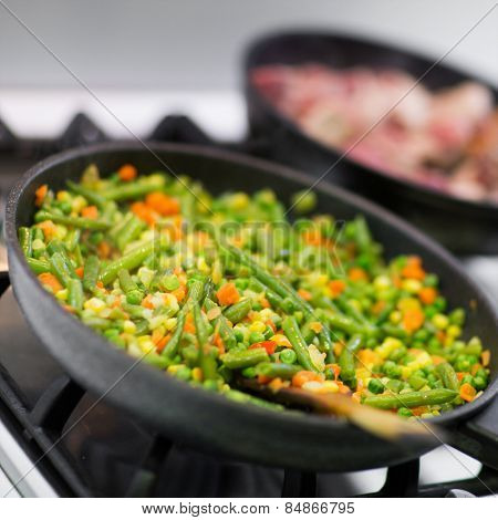 Stir fry vegetables in a wok cooking on the stove with selective focus
