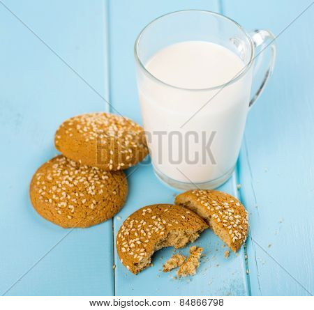 glass of milk and oat cookies