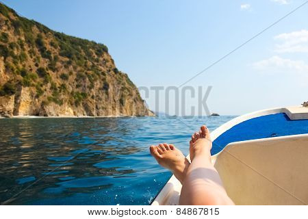 woman lounging on a catamaran sailboat