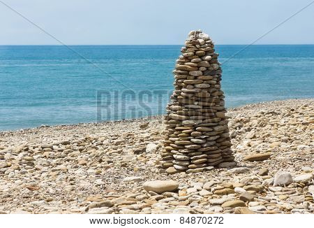 Pyramid Pebble On Sea Beach