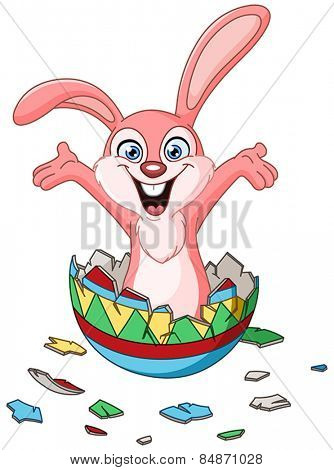 Happy bunny hatching from a colorful Easter egg