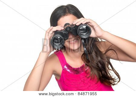 Beautiful teenage girl looking through a pair of binoculars isolated on white