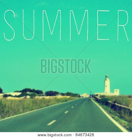 the word summer written on a blurred image of a quiet road leading to a lighthouse
