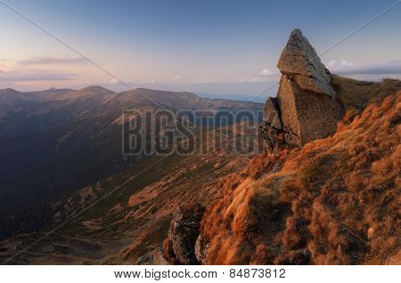 Evening landscape in the mountains. Beautiful nature. Stone on the mountainside. Carpathians, Ukraine, Europe