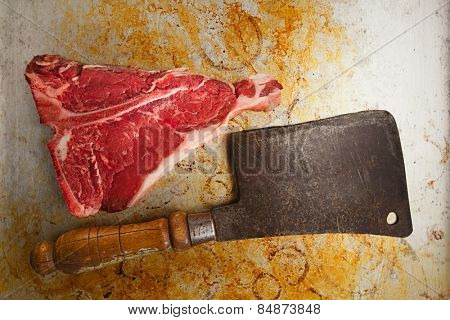 beef steak t-bone with vintage butcher cleaver knife