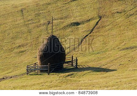 Haystack on a mountain meadow. Rustic look. Carpathians, Ukraine, Europe