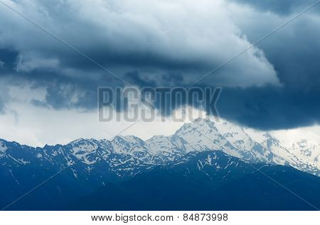 Snowy mountain ridge in the clouds. Georgia, Svaneti ridge