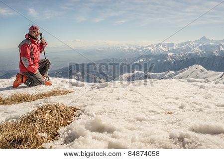 Alpinist On The Mountain Top