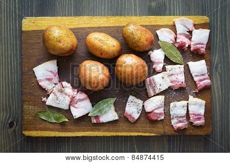 Traditional Ukrainian food. Potatoes and bacon. Preparing food on a wooden board