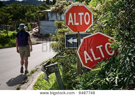 Hiker Near Signs In Santa Elena Costa Rica