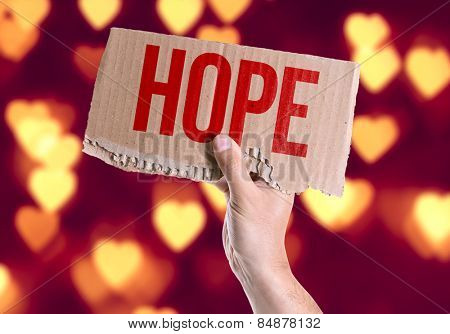 Hope card with heart bokeh background