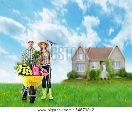 Gardening people. Couple with flowers in the garden.