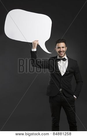Handsome latino young man holding a speach balloon