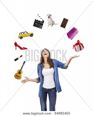 Happy woman trying to catch something falling from the sky