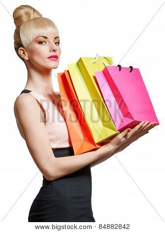 Woman holding shopping bag isolated on white background