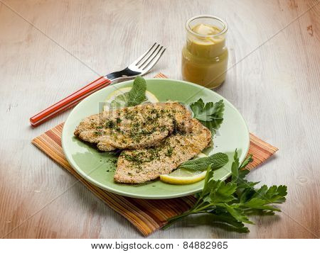 breaded cutlet with herbs and mustard