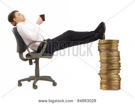 Businessman resting in armchair with legs up isolated on white background