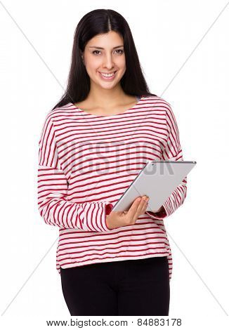 Mixed Indian woman use of tablet