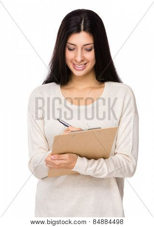 Mixed indian woman write on clipboard