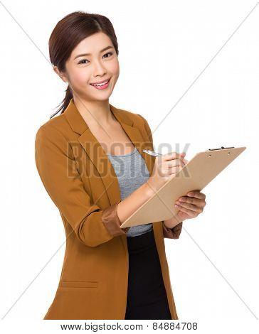 Business woman write on clipboard