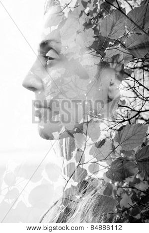 Double exposure of woman combined with photograph of leaves