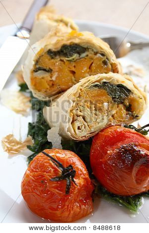 Close-up of filo parcels with roasted tomatoes