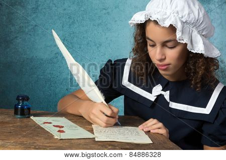 Young victorian girl in vintage dress and bonnet writing a letter