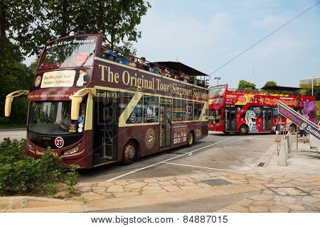 SINGAPORE - JANUARY 26, 2015: Singapore has over 10 million visitors each year. The Original Tour Singapore Sightseeing and Hippo City Sightseeing - this companies offering Singapore City bus tours.