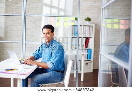 Businessman in casualwear sitting in office