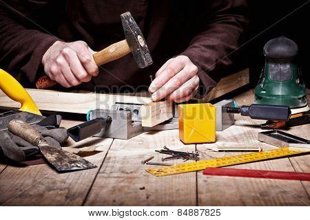 closeup of carpenter work with hammer tool