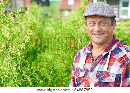 Portrait of a smiling professional farmer