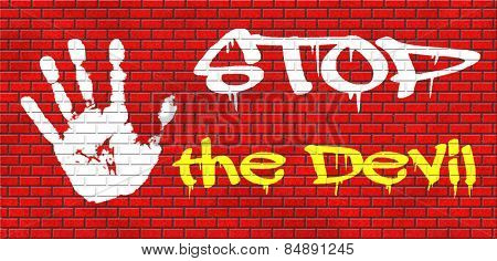 stop the devil no evil or sinning graffiti on red brick wall, text and hand