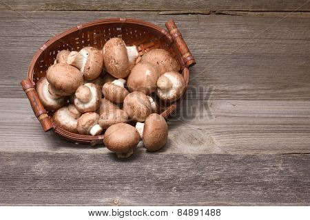Fresh Brown Champignons On Wooden Background