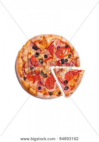 Top view of delicious pizza with ham, tomatoes, and olives, isolated on white background