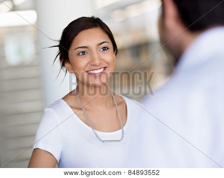 Young business woman having conversation with her collegue