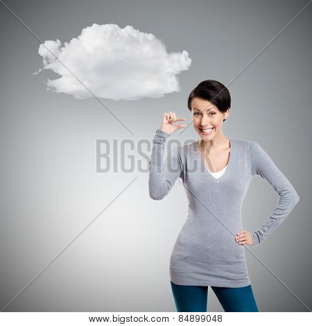 Attractive woman gestures small amount, isolated on grey background with cloud