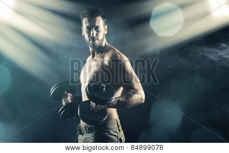 Male Body Builder Working Out With Dumbbells
