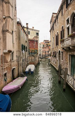 Narrow Channel With Citizen Boats In Venice