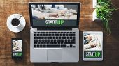 foto of enterprise  - Start up corporate identity website on laptop digital tablet and smart phone business desktop - JPG