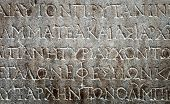 pic of greek  - ancient Greek writing chiseled on brown stone - JPG