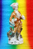 stock photo of figurine  - porcelain figurine on a colored background  germany - JPG