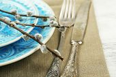 stock photo of pussy-willows  - Easter table setting with pussy willow branches on color wooden background - JPG