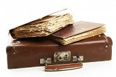 stock photo of old suitcase  - Old wooden suitcase with old books isolated on white - JPG