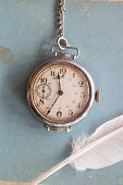 picture of politeness  - Old watches on a blue background and feather vintage - JPG