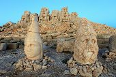 foto of king  - East terrace of Mount Nemrut at sunrise with the head in front of the statues - JPG
