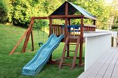 picture of swingset  - Wooden playset in a backyard - JPG